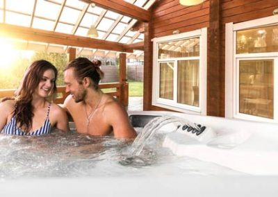 A couple relaxing in a hot tub